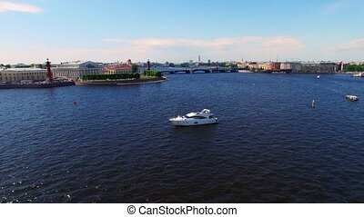 Luxury yacht in a city river with newlyweds aerial