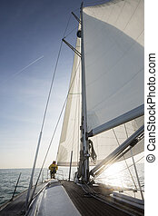 Luxury Yacht In Sea On Sunny Day - Mature man sailing on...