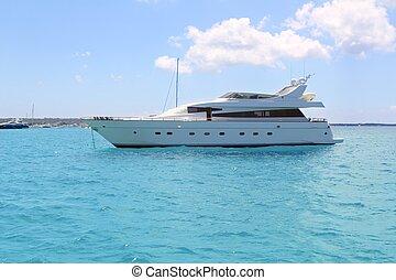 luxury yacht in turquoise Illetes Formentera mediterranean sea Balearic Islands