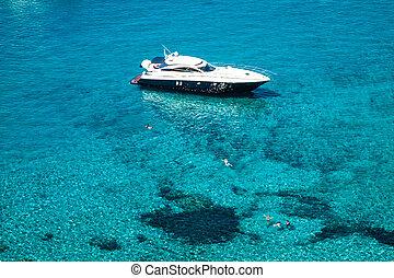luxury yacht in turquoise Illetes Formentera mediterranean sea B