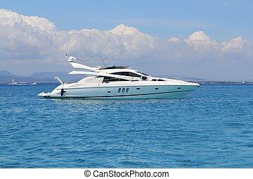 luxury yacht in turquoise Illetes Formentera mediterranean...