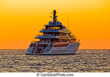 Luxury yacht on open sea at sunset - Luxury yacht on open...