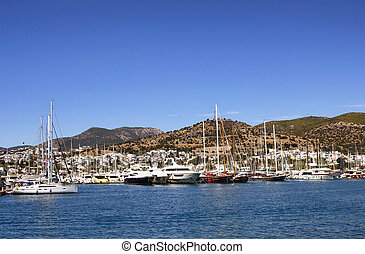 Luxury yachts and sail boats parked at Bodrum marina in a...