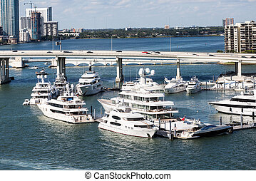 Luxury Yachts Birthed in Miami - Yachts near Bridge in...