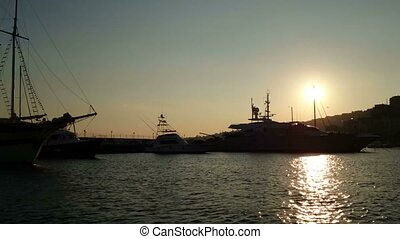 Luxury yachts docked in Naples
