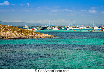 Luxury yachts in turquoise beach of Formentera Illetes