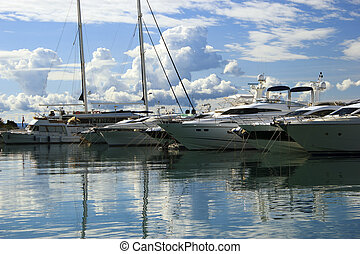 Luxury yachts moored on pier - Group of luxury motor yachts...