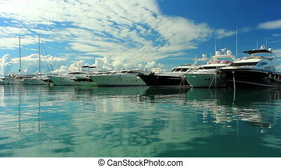 Luxury yachts moored on pier - Luxury motor yachts moored on...