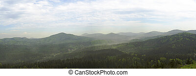 luzicke hory mountains wide panorama, skyline view from hill stredni vrch, green forest and blue sky, white clouds background