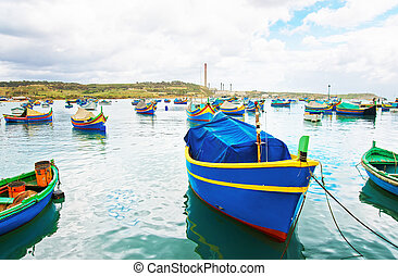 Luzzu colored boats at Marsaxlokk Bay in Malta