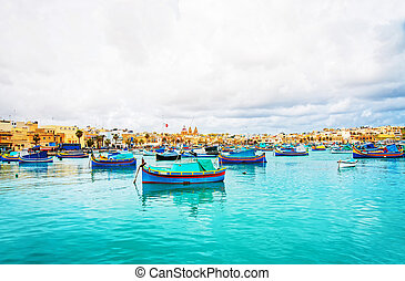 Luzzu colored boats at Marsaxlokk Bay on Malta
