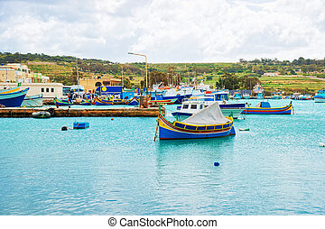 Luzzu colored boats at Marsaxlokk Harbor Malta