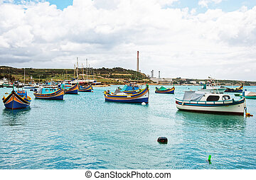 Luzzu colored boats at Marsaxlokk Harbor of Malta