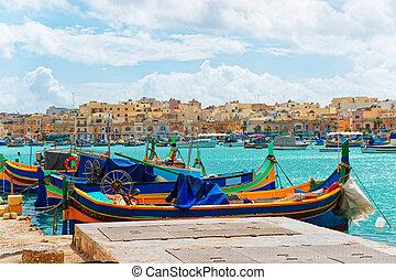 Luzzu colorful boats at Marsaxlokk Bay on Malta