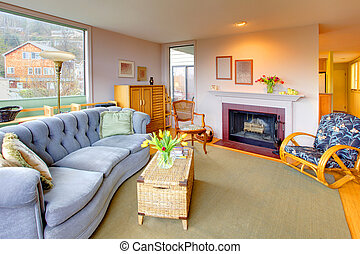 Lving room with fireplace and cozy blue sofa