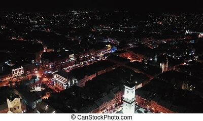 Lviv, Ukraine - 4, January 2019. Arial shot. Rynok square street. Christmas Fair. Lvov Town Hall. Christmas decorations and lights. Night time