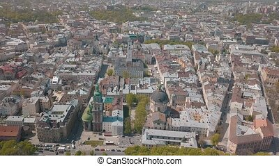 Lvov, Ukraine. Aerial Roofs and streets old city Lviv. Central part of old city. European city in spring. Panorama of the ancient town. Town Hall, Council, Ukraine Dominican Church. Drone shot