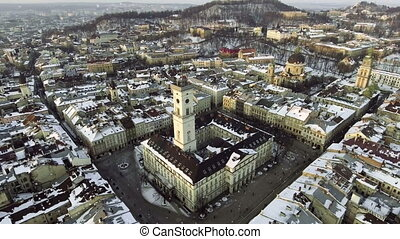 LVOV, UKRAINE. Ukraine Lviv City Council, Town Hall, the tower. Panorama of the ancient city. The roofs of old buildings. Streets Arial.