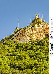 Low angle shot rocky peak, lycabettus hill, athens, greece