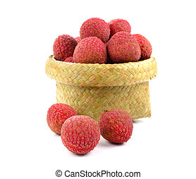 Lychees in a wicker basket on a white background.