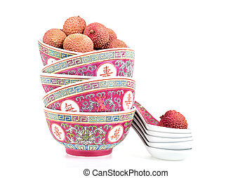 Lychees in bowls with spoons