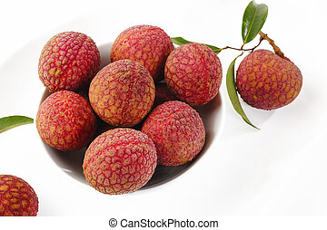 lychees in white bowl