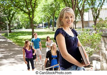 lycklig, blond, högskola studerande
