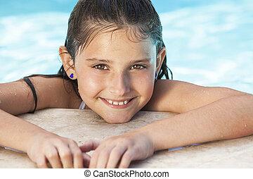 lycklig, flicka, barn, in, badbassäng