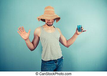 lycklig, ung man, drickande, från, blå, kopp