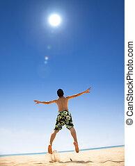 lycklig, ung man, hoppning, stranden