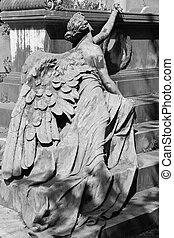 Lying angel sculpture at the tomb on monumental cemetery of Staglieno, Genoa, Italy, Europe
