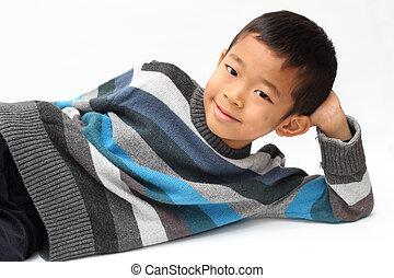 Lying Japanese boy (first grade at elementary school)