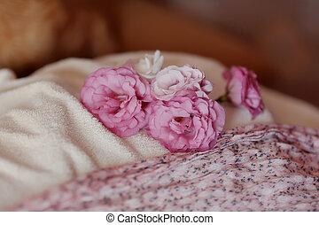 rosebuds - lying on a white blanket pink rosebuds