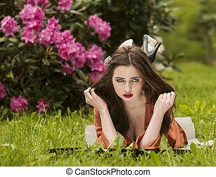Lying on grass