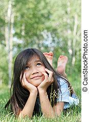 Lying on grass, thinking