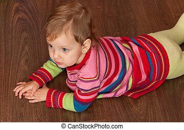 Lying on the wooden floor
