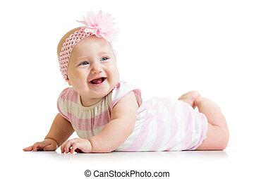 lying smiling baby girl isolated on white background