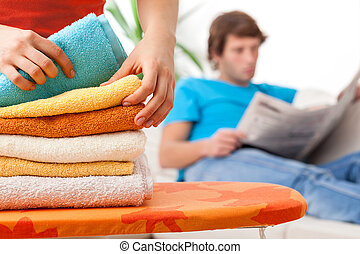 Lying towels after laundering - Young woman lying colorful ...