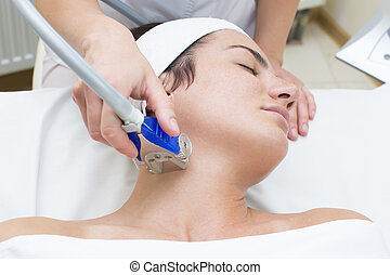 lymphatic drainage massage apparatus process is a girl in a beauty salon