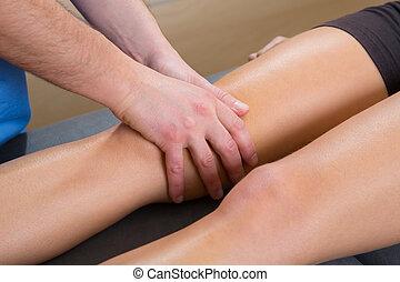 lymphatic drainage massage therapist hands on woman leg knee