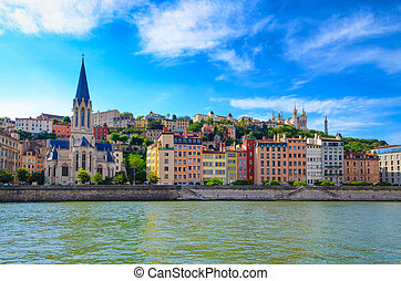 Lyon cityscape from Saone river with colorful houses and ...