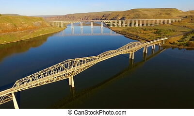An automobile and railroad bridge both span the Snake River in Eastern Washington near Lyon's Ferry State Park
