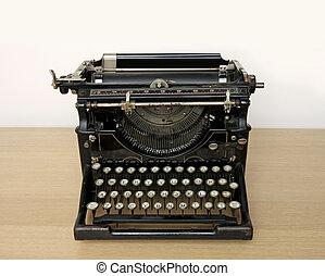 máquina de escribir antigua, en, un, escritorio de madera