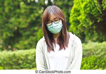máscara pesada, mujer, parque