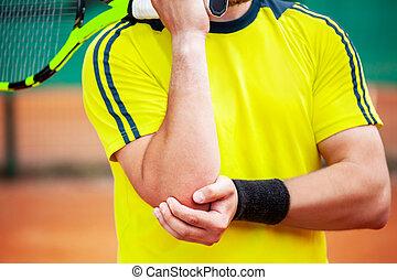 mâle, tenue, sien, elbow., joueur, tennis, blessé