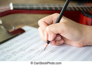 mão, com, lápis, e, folha música