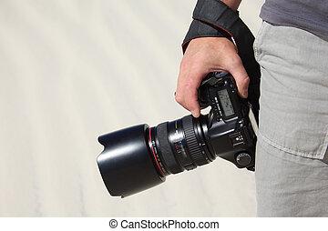 mão, segura, câmera foto