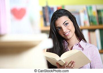 mãos, livro, câmera., modelo, -, aluno feminino, sorrindo, ...