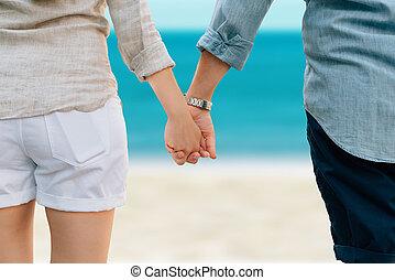 mãos participação par, praia