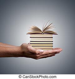 mãos, segurando, empilhado, livros, branco, fundo